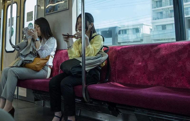 Woman sitting on seat in train