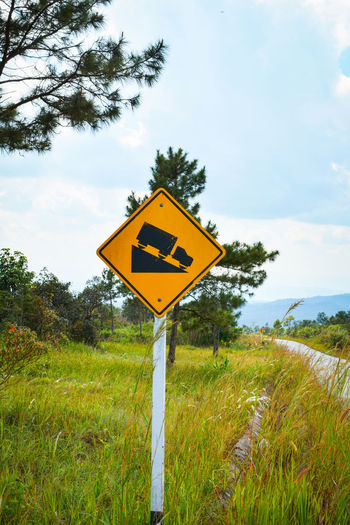Road sign Steep Slope warning traffic and truck on hill mountain Arrow Attention Background Blue Car Caution Concept Cross Danger Dangerous Direction Down Downhill Drive Gear Grade Highway Hill Icon Information Landscape Light Mountain Nature People Retro Road Roadside Roadsign Safety School Sign Sky Slope Speed Steep Street Symbol Traffic Transport Transportation Travel Truck Turn Up Vintage Warning Way White Winding