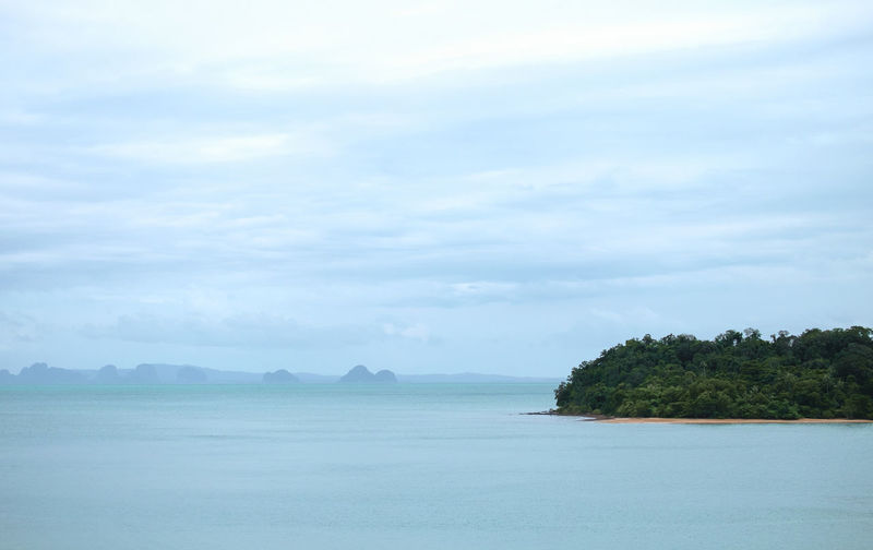 Marine tourism in Southeast Asia Sky Tranquil Scene Beauty In Nature Cloud - Sky Tranquility Scenics - Nature Water Sea Tree Plant No People Nature Idyllic Waterfront Day Non-urban Scene Land Outdoors Environment