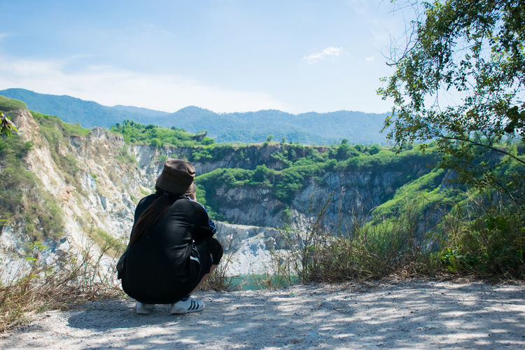 GRAND CANYON, travel in Chonburi, thailand One Person Real People Nature Outdoors Travel Lake Mountain Mountain Range Mine Old Mine Beauty In Nature Leisure Activity Day Scenics - Nature Lifestyles Looking At View Sitting Hat Rear View Vacations Vacation Grand Canyon