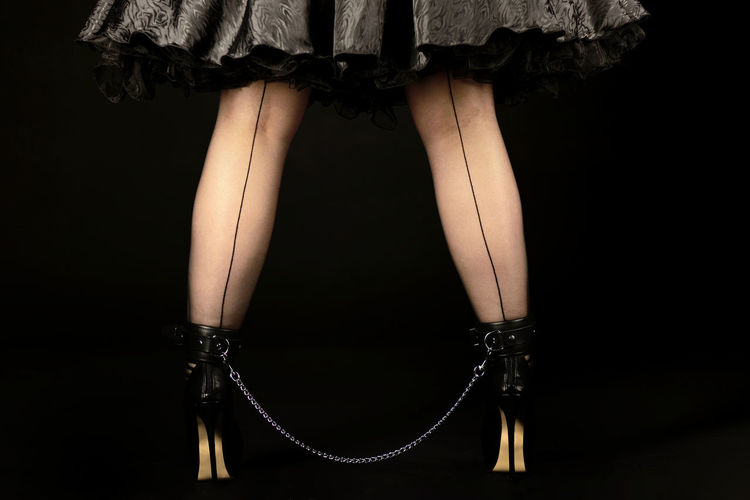 Woman legs tied in high heels with chain High Heels ❤ Leather Woman Adult Adults Only Black Background Chain Close-up High Heels Human Body Part Human Leg Indoors  Low Section One Person People Tied Young Adult