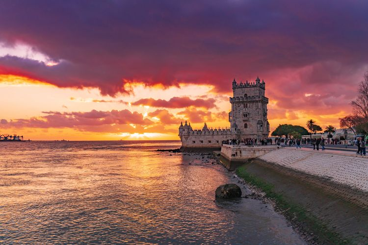 Belém Belem Tower Sunset Portugal EyeEm Selects Sunset Sky Architecture Water Built Structure Building Exterior Cloud - Sky Building Sea Nature Tower Orange Color Travel Destinations Land Scenics - Nature Beauty In Nature History No People