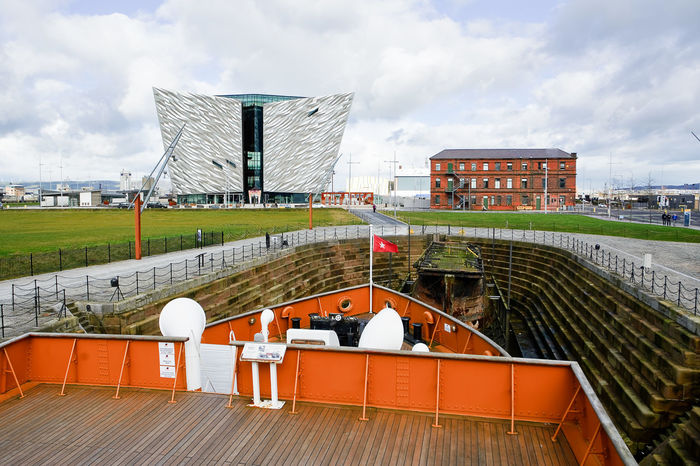 Belfast, United Kindom - febrary 22, 2016: Titanic Museum Palace vieved from Nomadic deck Antrim Belfast Boat Deck Dock Dockland Harbor Ireland KINGDOM Museum Nomadic Northern Quarter  Ship Shipyard Titanic Uk Ulster