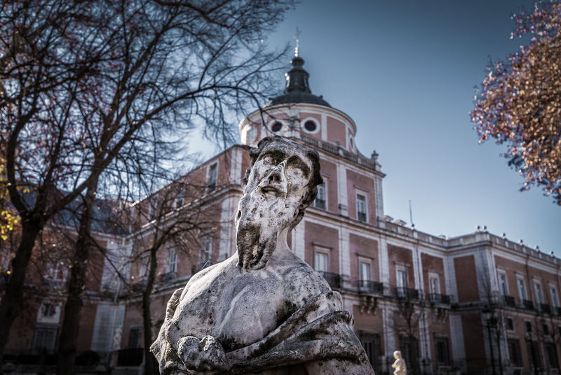 Royal Palace, Aranjuez Architecture Bare Tree Branch Building Exterior Built Structure Clear Cold Day Face Façade Garden Historic Low Angle View Madrid No People Outdoors Palace Royal Sculpture Sky Statue Tinte Torso Tree