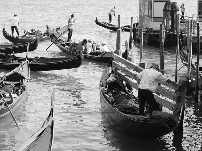 People in gondolas on grand canal in city