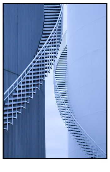 Oil cisterns in Fredikshaven, Denmark Architecture Blue Denmark Fredikshaven Indurstial Oil Cistern Stairs Tower