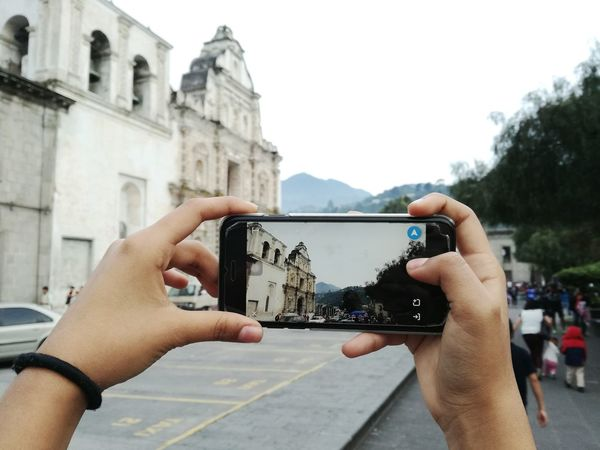 Photographing Photography Themes Smart Phone Human Hand Human Body Part Portable Information Device Wireless Technology Mobile Phone Adult Day Outdoors People Selfie Technology Only Men Architecture One Person Close-up