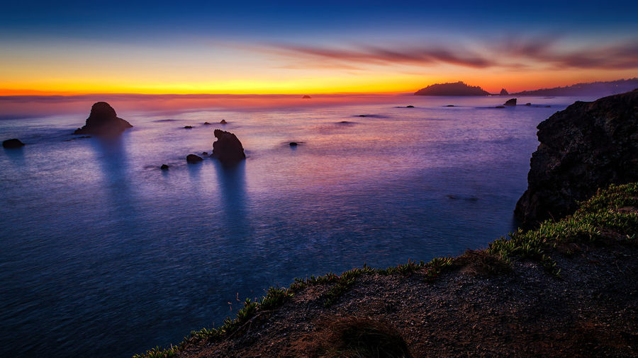 Don't fall. Ocean View Pacific Sunlight Sunset_collection Beauty In Nature Day Horizon Over Water Mountain Nature Ocean Outdoors Real People Rock - Object Scenics Sea Sea And Sky Seascape Seaside Silhouette Sky Sun Sunset Tranquil Scene Tranquility Water