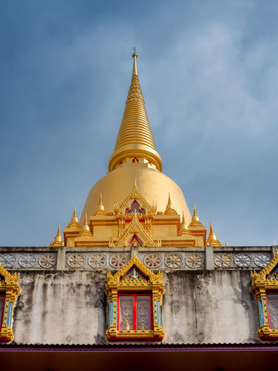 The thai pagoda traditional building against sky