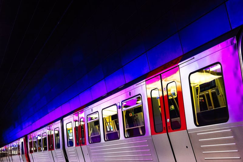 Illuminated Subway Train At Station