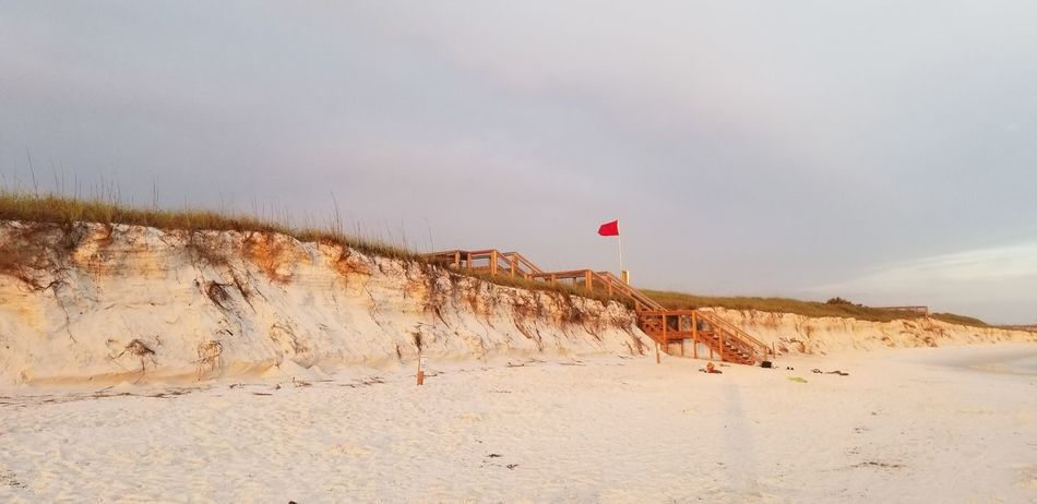 doesn't look like a red flag day to me. EyeEm Selects Sand Dune Flamingo Flying Beach Sand Desert Sky Landscape Tranquil Scene Idyllic Shore Non-urban Scene Calm Ocean Coast