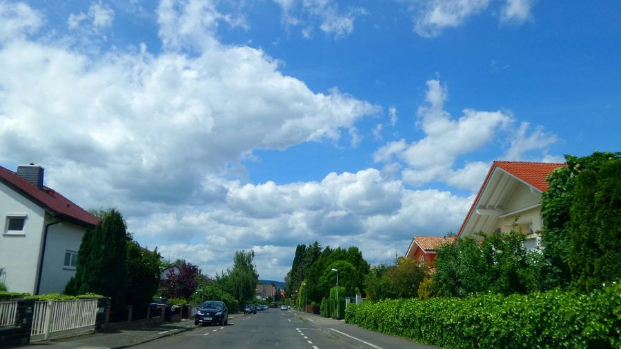 View of road against cloudy sky