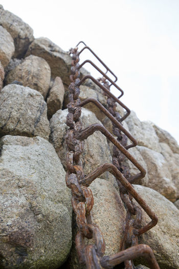 Industrial Ladder Mousehole, Cornwall Chain Ladder Chains Day Harbour Wall History Ladder To The Sky Metal No People Old Outdoors Rusty Sky Stones Strength Way Up