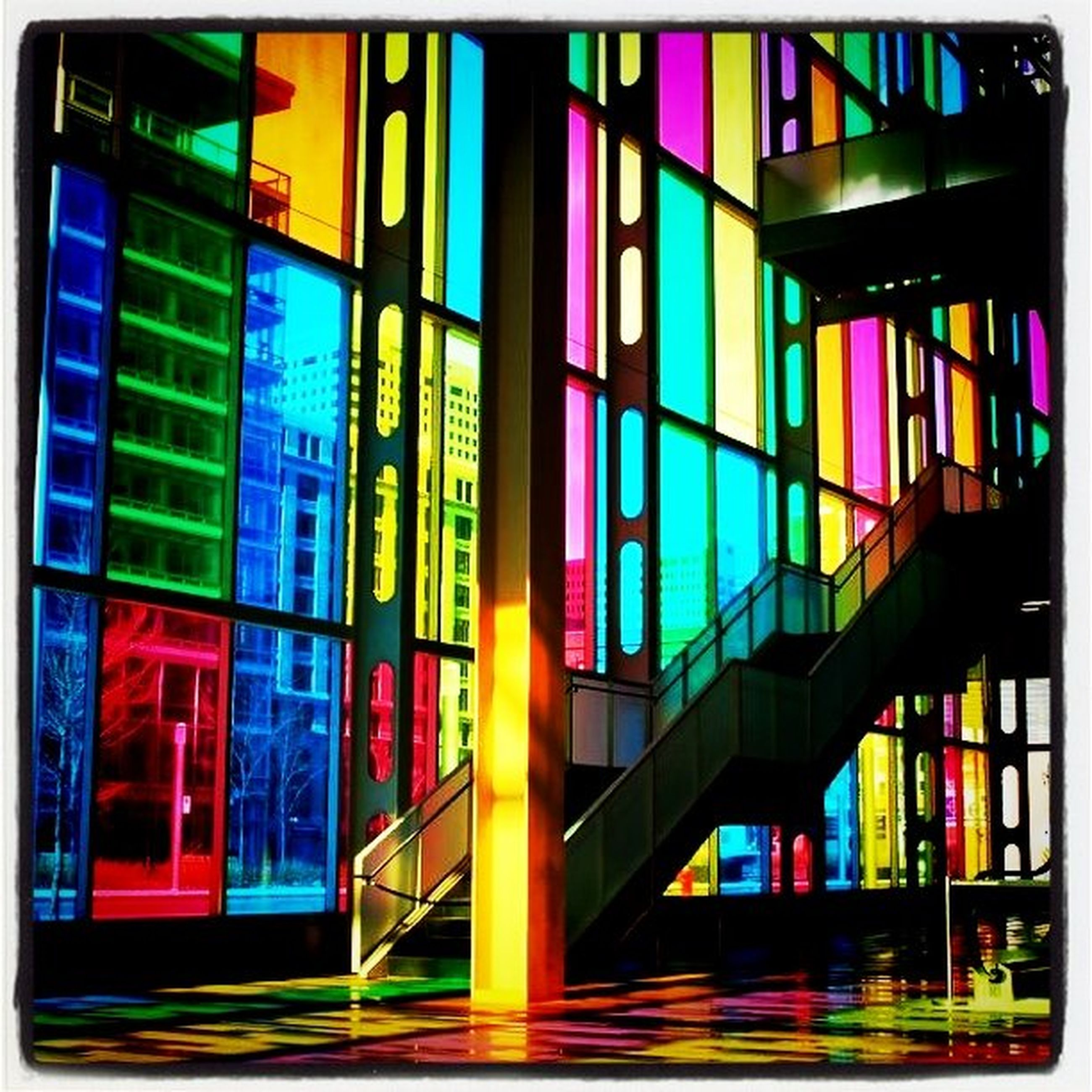illuminated, multi colored, architecture, building exterior, night, built structure, city, window, transfer print, auto post production filter, colorful, in a row, no people, indoors, building, lighting equipment, residential building, modern, variation, glass - material