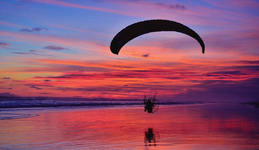 Sunset Sky Parachute Sea Adventure Silhouette Cloud - Sky Nature Outdoors Extreme Sports Leisure Activity Beauty In Nature Flying Sport Paragliding Real People