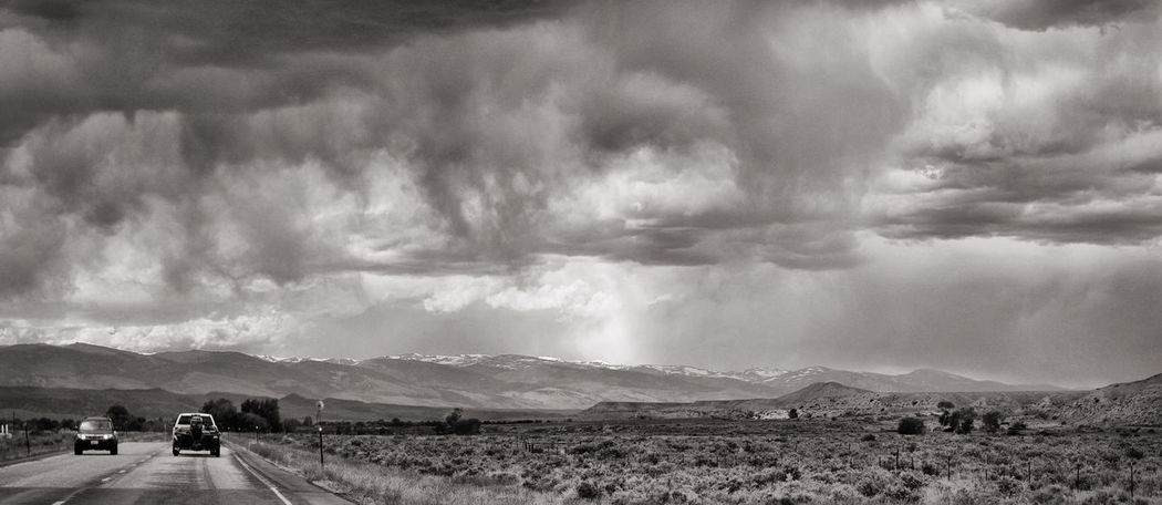 Dark Clouds Dramatic Sky Landscape_Collection Leading Lines Beauty In Nature Blackandwhite Cloud - Sky Day Landscape Monochrome Mountain Nature Outdoors Road Scenics Storm Clouds The Way Forward Transportation Two Cars