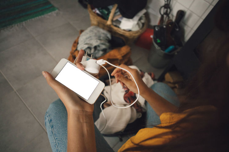 High angle view of woman using mobile phone