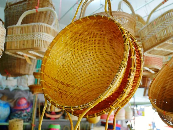 Low angle view of wicker container hanging in market stall
