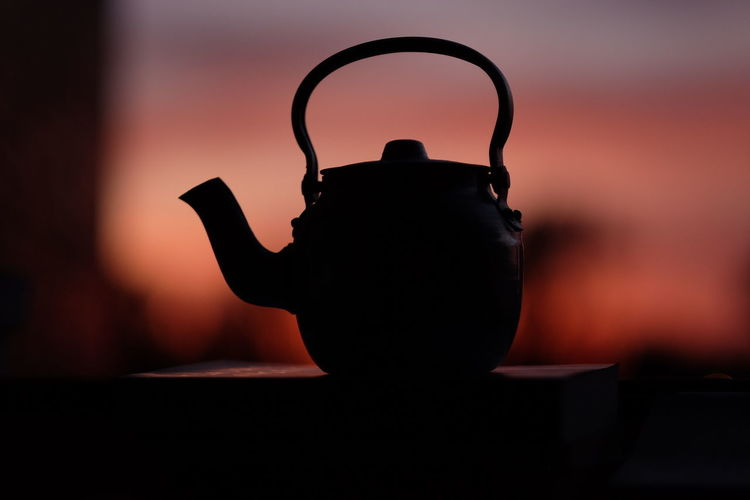 Close-up of silhouette on table at home