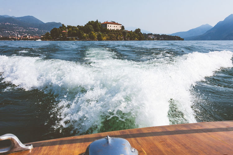 Clear Sky Day Island Italy Lago Maggiore Lake Luxury Motion Nature Nautical Vessel Outdoors Scenics Speedboat Transportation Water Wave An Eye For Travel Adventures In The City It's About The Journey