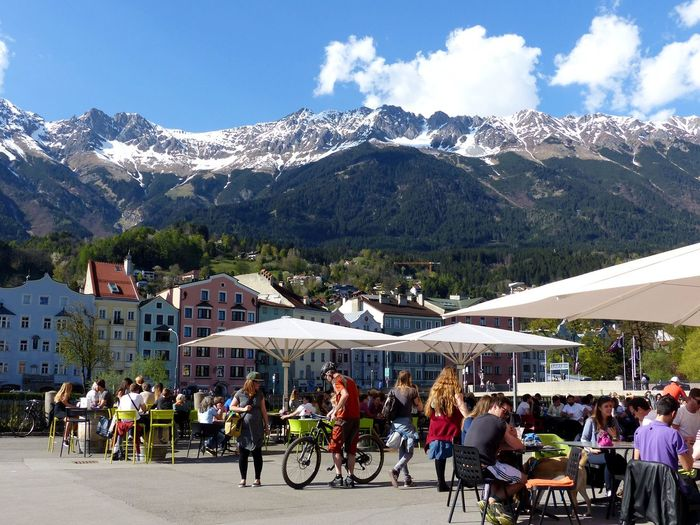 Austria Austrian Alps Eating And Drinking Europe Fun In The Sun Innsbruck Innsbruck Altstadt Innsbruck Market Square Innsbruck Marktplatz Nordkette Real People Snowcapped Mountain Summer In Europe Summer In The City Town Square Tyrol