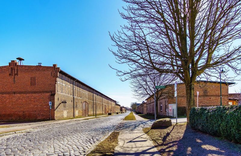 Pinnow Blue Sky Perspective Photography Urban Street Streetphotography Village Day Architecture Built Structure Outdoors Sky Shadow Sunlight No People Building Exterior