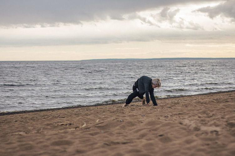 Full length of man on beach against sky