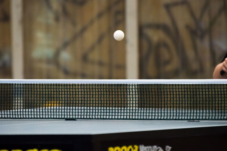 Ball in mid-air above table tennis table