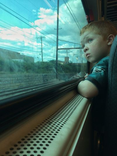 Snap a Stranger Train Commuting Kid Boy Window Staring Red Hair Traveling Home For The Holidays Long Goodbye