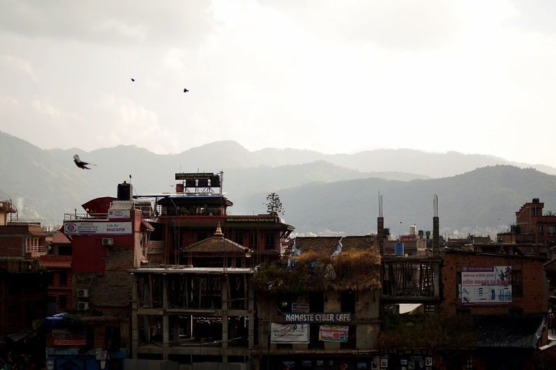 Cityscape of Bhaktapur. Cityscape Nepal Sky Architecture Mountain Built Structure Building Exterior Bird Nature Mountain Range Building No People Animal Flying Vertebrate City Animal Themes Animals In The Wild Outdoors Cloud - Sky Day A New Beginning