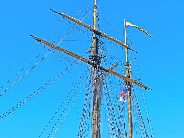 Tall Ship Mast Bay City Blue Cable Clear Sky Clear Sky Cross Shape Day Flag Flags Low Angle View Mast Michigan Nature No People Outdoors Rope Work Ropework Sailboat Ships Mast Sky Tall Ship Tallships Wood Pole Wooden