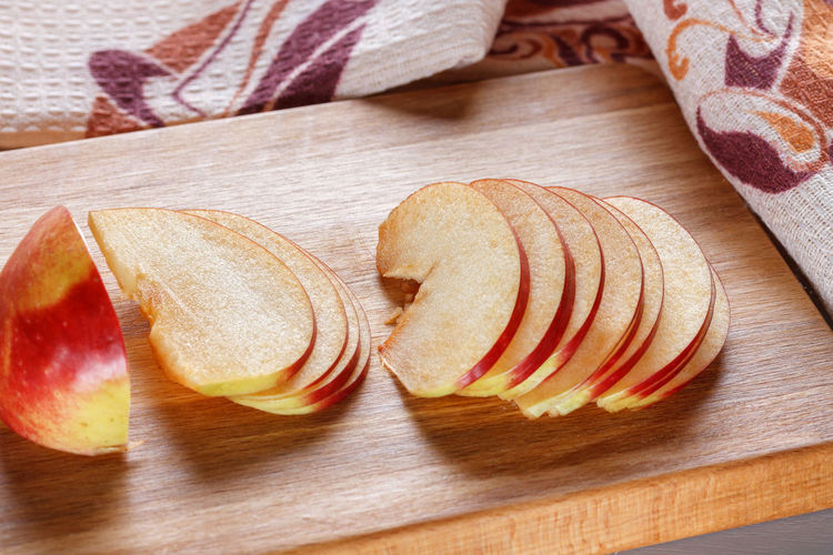 Thinly sliced slices of fresh apple on a kitchen board. Cooking Cut Natural Apple - Fruit Board Close-up Cutting Board Day Food Food Photography Fresh Freshness Healthy Eating High Angle View Indoors  Kitchen Macro No People SLICE Sliced Tasty Thinly Towel Wood - Material
