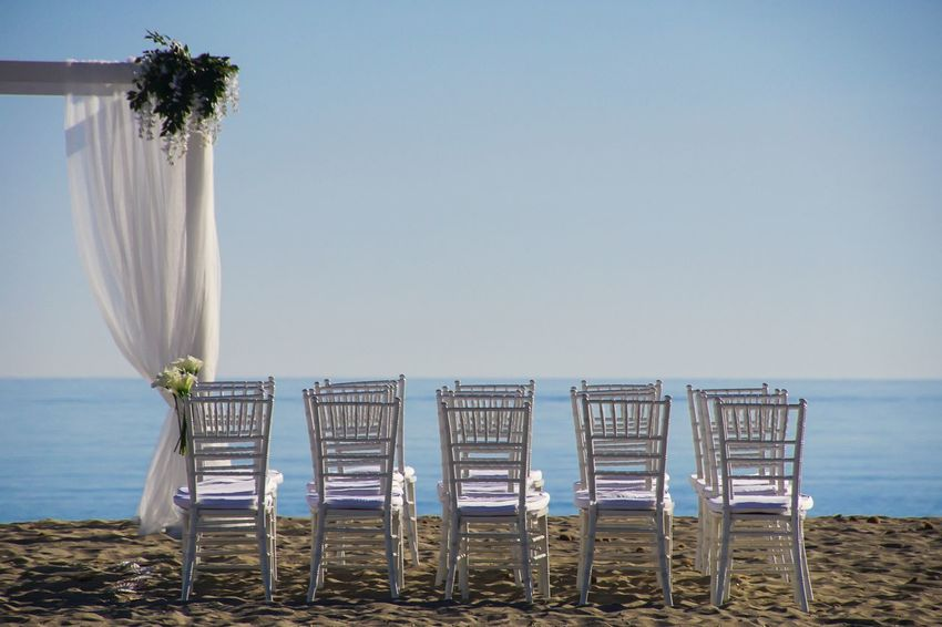 prepared for the the great day - beach at Mallorca Sea Beach Flowers Wedding Sonne Hochzeit Outdoors Ocean Blumen Beach Photography Pattern Strand Shore Wedding Day Row Scenics Absence Stühle Stuhl Wedding Photography Weddings Around The World Horizon Over Water Sitze A New Perspective On Life