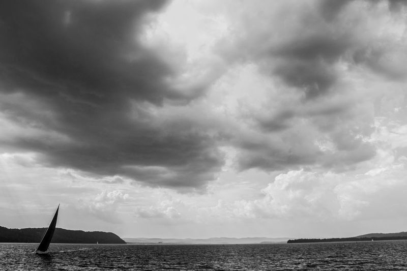 Sailing Out of the Storm Sailboat Boating Ocean River Blackandwhite Clouds And Sky Storm Storm Cloud Essence Of Summer