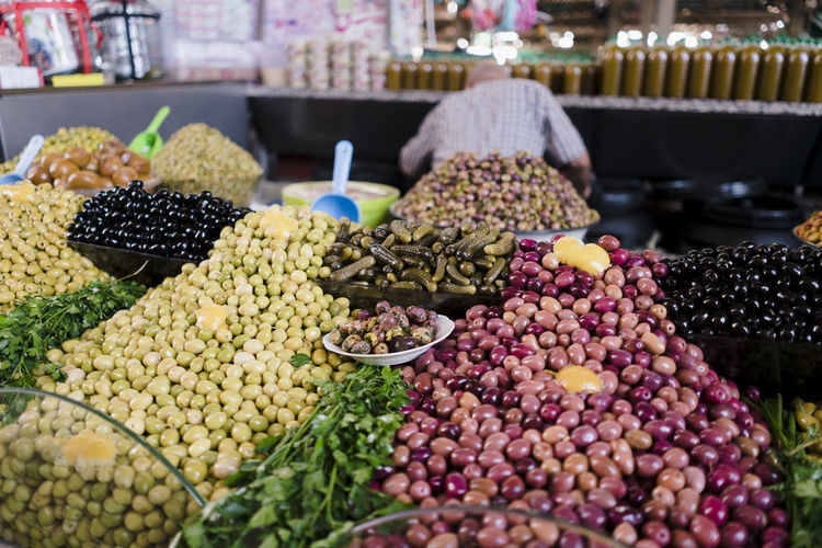 Marocco Landscape Africa North Africa Market Food Freshness Agadir Oranges Peppers Madarines Bananas Tomatoes Food And Drink Healthy Eating Choice Variation Retail  Market Stall For Sale Wellbeing Large Group Of Objects Fruit Abundance No People Olive Focus On Foreground Selective Focus Still Life Close-up Retail Display Morocco Morocco Landscape