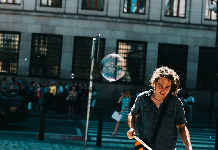 Bubbles Building Exterior Architecture Standing Built Structure Leisure Activity Lifestyles Casual Clothing City Focus On Foreground City Life Person Front View People And Places EyeEm Best Shots Street Photography