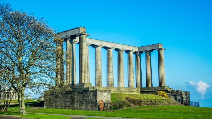 The ancient architecture on calton hill Edinburgh Scotland. Sky Architectural Column Architecture Built Structure History Blue The Past Nature Ancient No People Plant Day Grass Ancient Civilization Clear Sky Old Ruin Travel Destinations Low Angle View Tree Copy Space Outdoors Archaeology Ruined Calton Hill Edinburgh Scotland Edinburgh Scotland Edinburgh Festival Fringe 2016 Fringe Show Actors Actresses