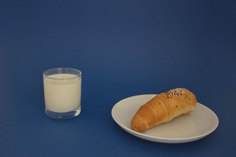 Food And Drink Food Still Life Bread Indoors  Freshness Studio Shot Blue Ready-to-eat Blue Background Baked No People Drink Colored Background Refreshment Meal Close-up Plate Bun Breakfast Glass Snack Milk White Copy Space