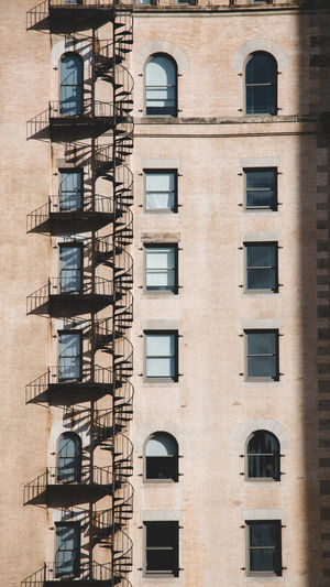 Endless Spiral Architecture Building Exterior Built Structure Fire Escape Low Angle View Residential District No People Building Window Emergency Exit Steps And Staircases Apartment Railing Safety Staircase Day