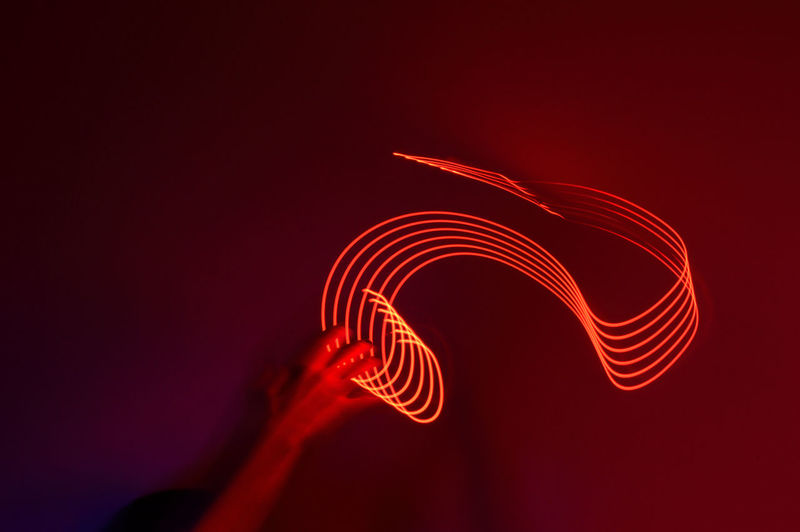 Close-up of light painting against colored background