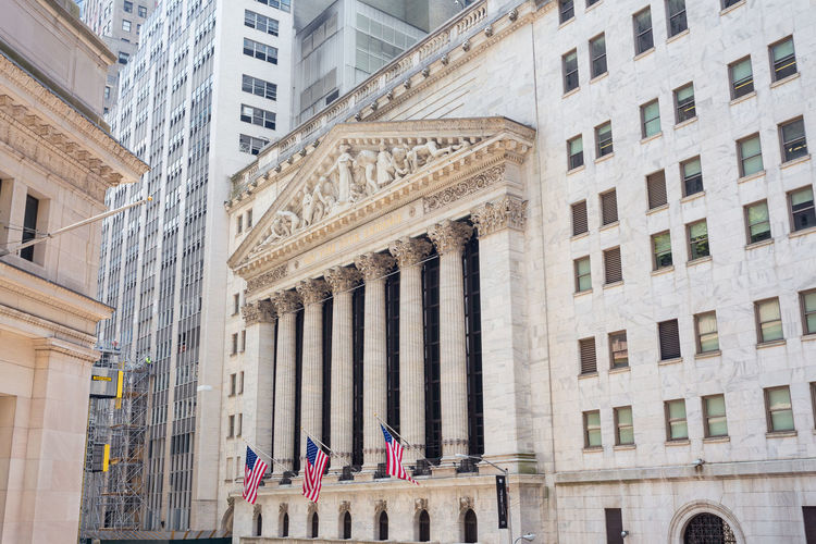 Manhattan NYC USA USA FLAG Architectural Column Architecture Building Exterior Built Structure City Columns And Pillars Day History Low Angle View Lower Manhattan Men New York Stock Exchange  Outdoors People Real People Stock Exchange Travel Destinations Wall Street  Windows Women