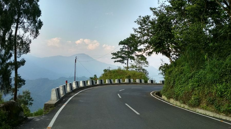 Gayabari Scenics Scenics - Nature View Travel Photography Travel Destinations Green Mountains Green Color Tree Road Winding Road City Panoramic Motorcycle Curve Sky Cloud - Sky Landscape Treelined Road Marking Diminishing Perspective Empty Road The Way Forward Country Road Two Lane Highway Mountain Road