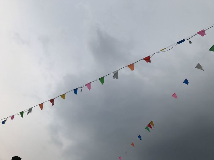 Bunting Celebration Cloud - Sky Cultures Day Flag Hanging Low Angle View Multi Colored No People Outdoors Sky Streamer Traditional Festival