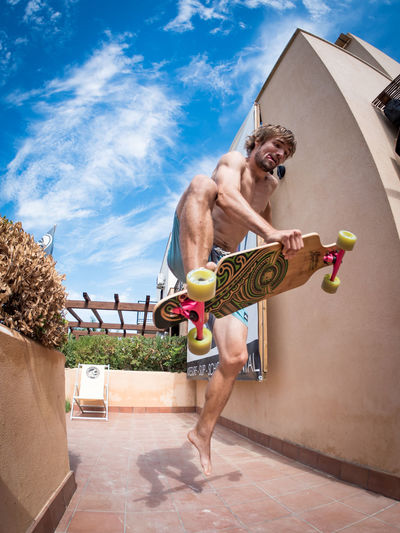 Adult Adults Only Archival Blond Hair Cloud - Sky Competition Day Full Length Low Angle View One Man Only One Person Outdoors People Shirtless Shorts Skate Sky Sport Summer Swimming Pool Tennis Young Adult