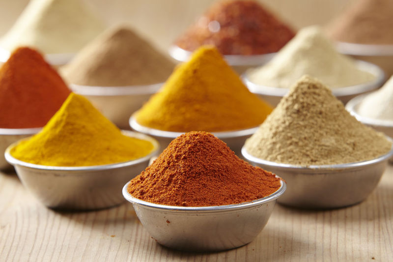 Aluminum container filled with colorful spices Chili Pepper Choice Curry Food And Drink Hot Red Spicy Aroma Assortment Cinnamon Colorful Cumin Flavor Food Ground - Culinary Ingredient Paprika Pepper Seasoning Spice Turmeric  Variation Wooden Background Yellow