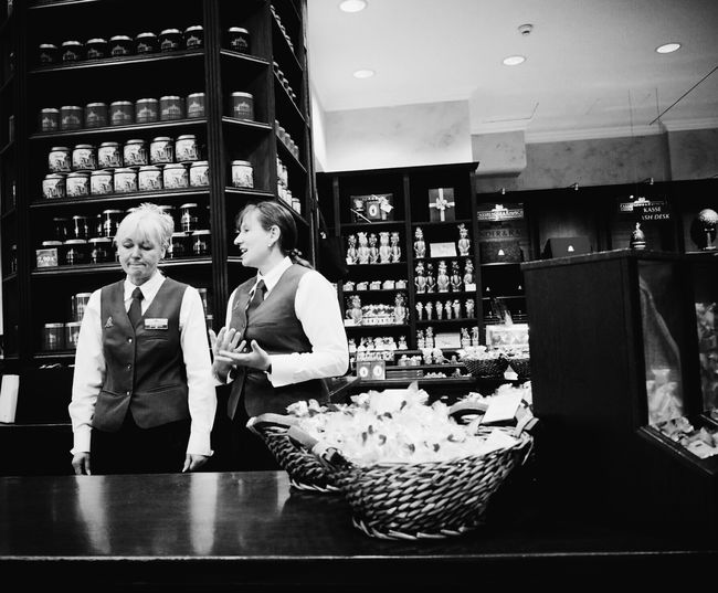 Chocolate-talk... Chocolatier  Chocolate Shop Streetphotography Streetphoto_bw Bw_collection Candid Candid Photography Candid Portraits People Watching People At Work Up Close Street Photography Hardworking Talking Welcome To Black