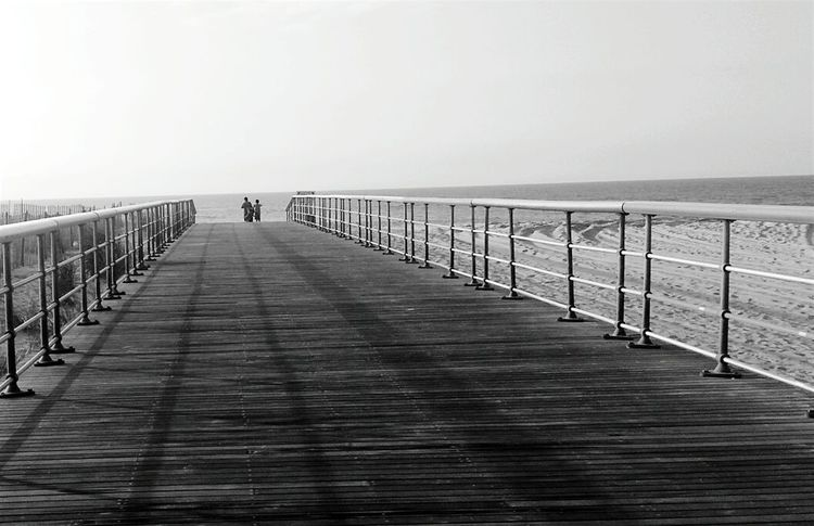 It's Summer time and living is easy Sea Pier Beach Outdoors Railing Horizon Over Water Wood - Material Travel Destinations Vacations Tourism Landscape Tranquil Scene Jetty Tranquility Nature From My Point Of View Blackandwhite Blackandwhite Photography Summer Taking Photos Black And White Nature Photographs Life Is A Beach No Color Popular Photos
