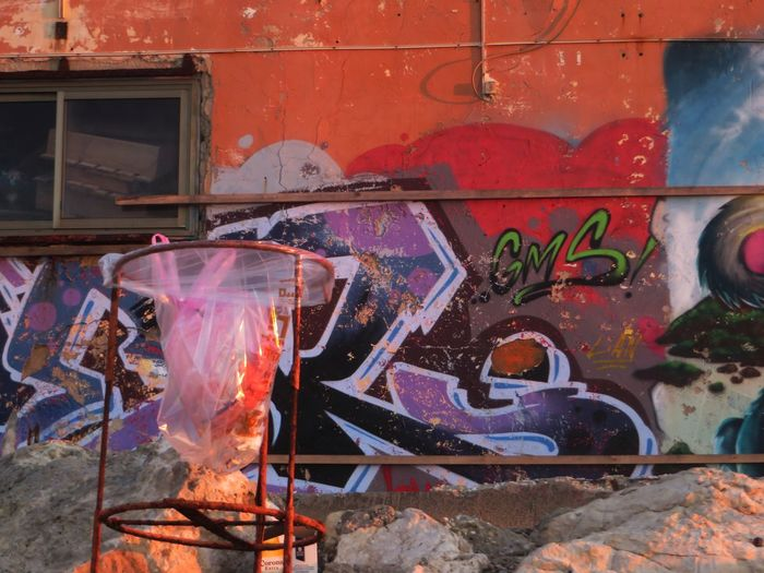 Abandoned Buildings Abandoned Places Day Graffit Wall Graffiti Graffiti Wall Multi Colored No People Object Focus Object Photography Outdoors Sunset_collection Text