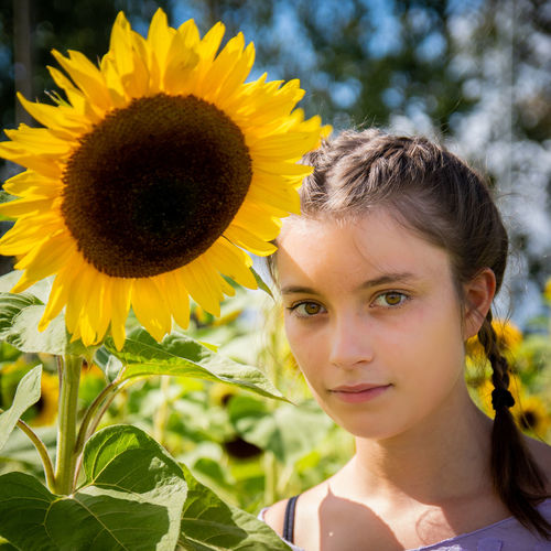 Portrait of a girl with sunflower