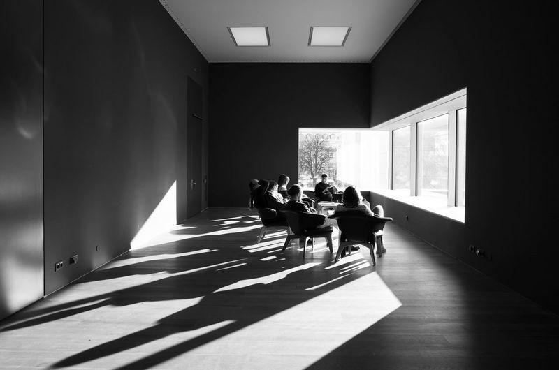 People sitting in corridor